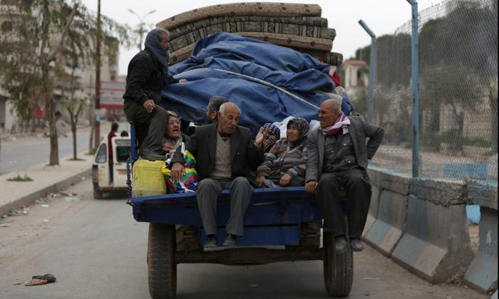 People ride in a truck with their belongings in the center of Afrin, Syria March 24, 2018. (Reuters/Khalil Ashawi)