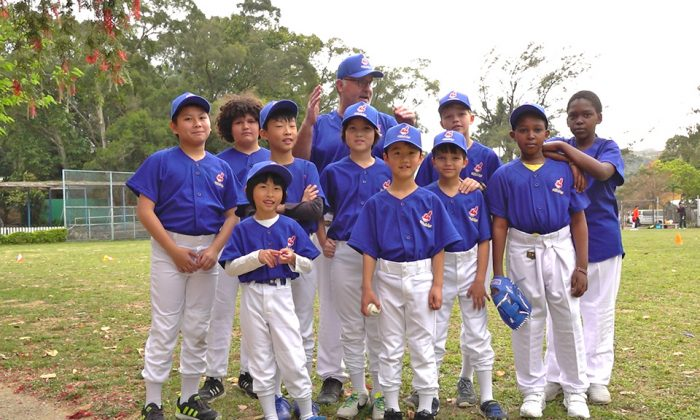 "Patrick Calkins (coach) together with some of his ""Tai Po Indians"" baseball team that played the league leaders ""Bombers"" in the HK Baseball Association's new Coach Pitch league at Fanling on Saturday March 17, 2018. (Bill Cox)"