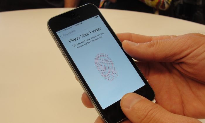 The iPhone 5s is pictured at a product launch, with the first fingerprint ID system incorporated in an iPhone, in 2013. (Glenn Chapman/AFP/Getty Images)
