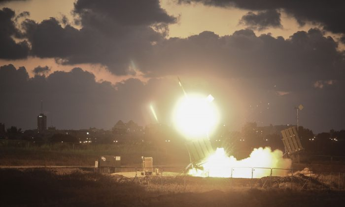 Israeli aircraft bombed a multi-story building in Gaza City on Thursday. File photo of an Iron Dome missile launch. (Photo by Ilia Yefimovich/Getty Images)