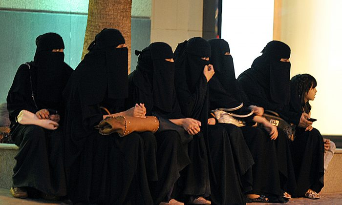 Saudi women wait for their drivers outside a shopping mall in Riyadh on Sept. 26, 2011 a day after King Abdullah granted women the right to vote and run in municipal elections, in a historic first for the ultra-conservative country where women are subjected to many restrictions. (FAYEZ NURELDINE/AFP/Getty Images)