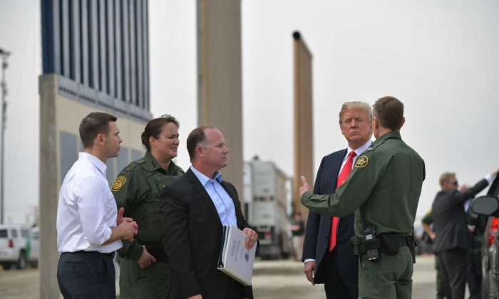 President Donald Trump inspects border wall prototypes in San Diego, California on March 13, 2018. (MANDEL NGAN/AFP/Getty Images)