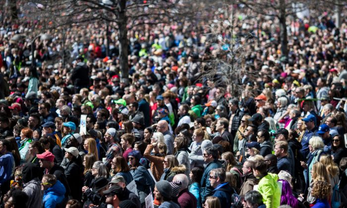 Demonstrators listen to speakers during the March for Our Lives rally March 24, 2018, in Washington. (Zach Gibson/Getty Images)