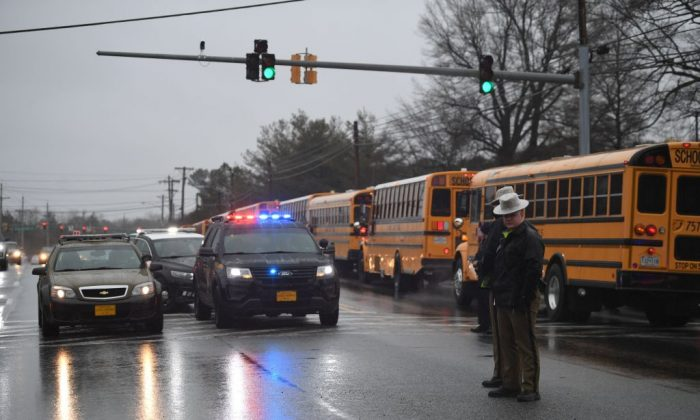 School buses, security and State Troopers are seen on March 20, 2018 at Great Mills High School in Great Mills, Maryland after a shooting at the school. (Jim Watson/AFP/Getty Images)