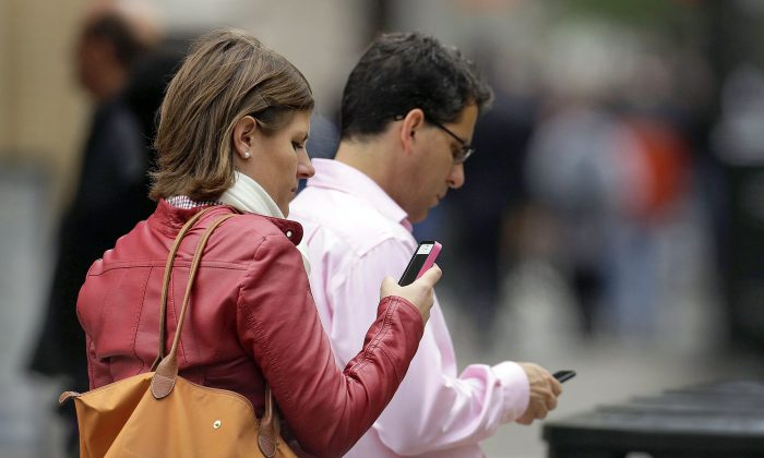 There's growing talk about adopting right-to-disconnect laws to free workers from being tethered to their phones around the clock. (AP Photo/Ben Margot, File)