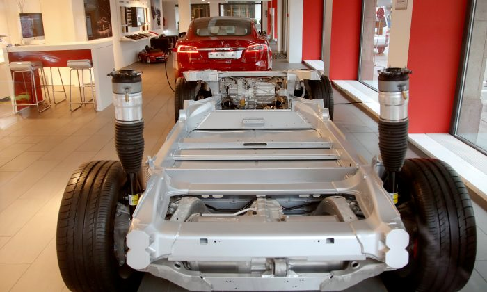A vehicle's chassis frame and a Tesla Model S 100D car stand in a showroom of U.S. car manufacturer Tesla in Zurich, Switzerland March 28, 2018. (ReutersArnd Wiegmann)