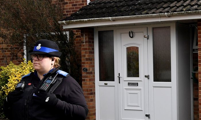 A police officer stands guard outside of the home of former Russian military intelligence officer Sergei Skripal, in Salisbury, Britain, March 6, 2018.  (Reuters/Toby Melville)