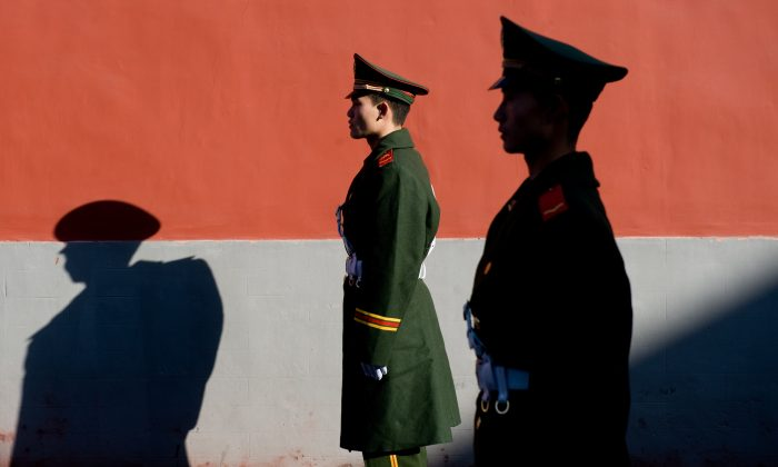 Members of the Chinese police stand guard in Beijing, China on November 17, 2009. (Saul Loeb/AFP/Getty Images)