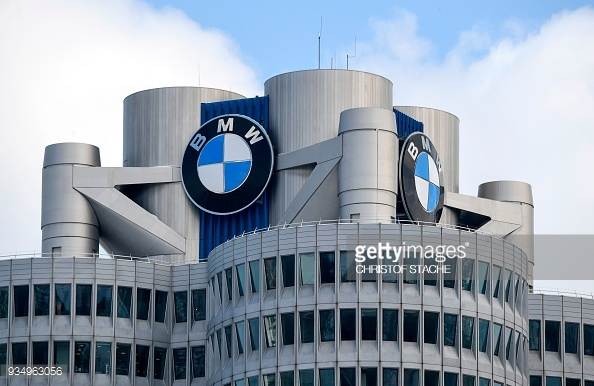 The BMW logo is seen on the top of the headquarters of German carmaker BMW in Munich on March 20, 2018.  / AFP PHOTO / CHRISTOF STACHE (Photo credit should read CHRISTOF STACHE/AFP/Getty Images)