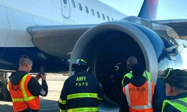 Officials inspect a jet turbine of Delta Flight 2836 which was grounded after it struck a bird on March 7, 2018 (Port Authority Police)