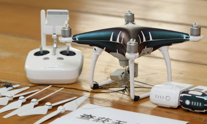 A drone that was confiscated after Chinese authorities arrested suspects who used drones to smuggle iPhones from Hong Kong to Shenzhen, pictured in Shenzhen City, Guangdong Province in China on March 29, 2018. (Liu Youzhi/Southern Metropolis Daily via Reuters)