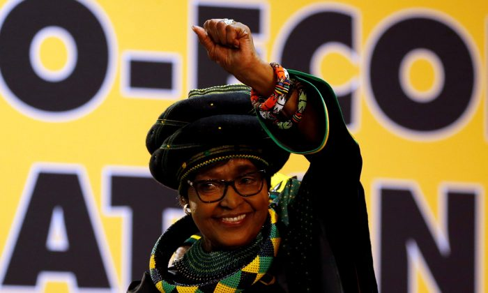 FILE PHOTO: Winnie Madikizela Mandela, ex-wife of former South African president Nelson Mandela, gestures to supporters at the 54th National Conference of the ruling African National Congress (ANC) at the Nasrec Expo Centre in Johannesburg, South Africa Dec. 16, 2017. (REUTERS/Siphiwe Sibeko/File Photo)