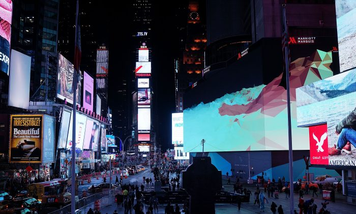 Advertisements are seen over Times Square in a file photo. Various groups, including businesses and governments, are vying for influence over perception and psychology. (Spencer Platt/Getty Images)