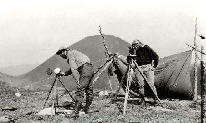 Surveyors mapping the boundary at the Yukon-Alaska border circa 1907. The line was supposed to be as straight as possible, despite running through uncharted wilderness in many regions. (JD Craig/International Boundary Commission)