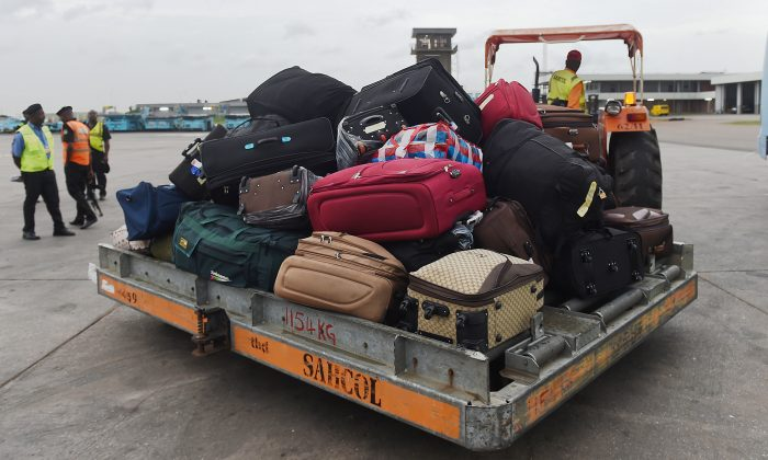 A truck arrives with luggage from Libya at Murtala Mohammed International Airport in Lagos, on March 23, 2017. (Pius Utomi Ekpei/AFP/Getty Images)