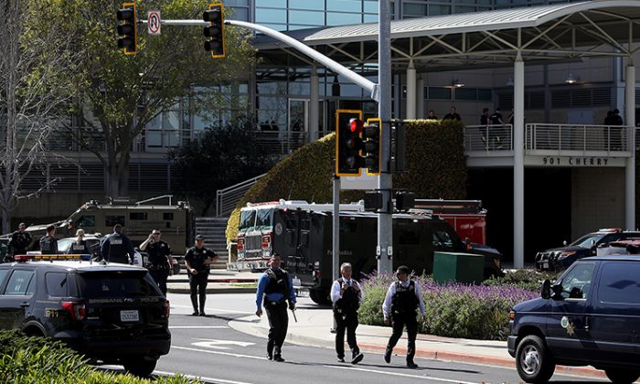 Police walk outside of the YouTube headquarters in San Bruno, California on April 3, 2018. (Justin Sullivan/Getty Images)