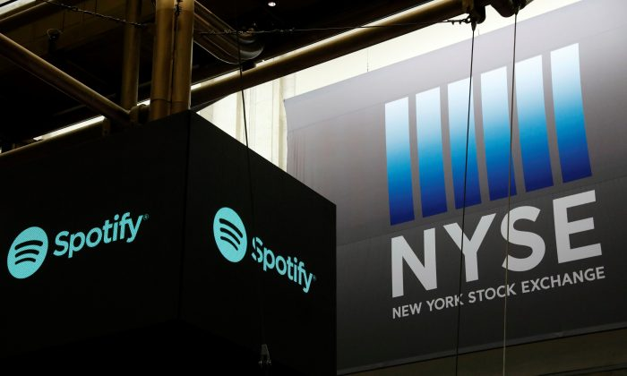 The Spotify logo hangs inside the New York Stock Exchange as the company lists its stock with a direct listing in New York, U.S., April 3, 2018. (Reuters/Lucas Jackson)