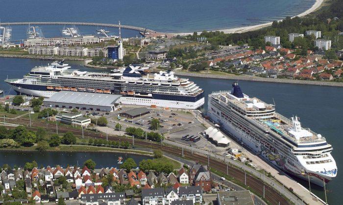 The Norwegian Jewel, right, a Norwegian Cruise Lines ship, is moored in Warnemuende, northern Germany. (Thomas Haentzschel/AP Photo)