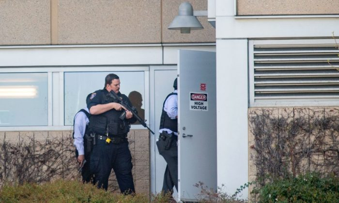Police search a building at YouTube's corporate headquarters as an active shooter situation was underway in San Bruno, Calif., on April 03, 2018. (Josh Edelson/AFP/Getty Images)