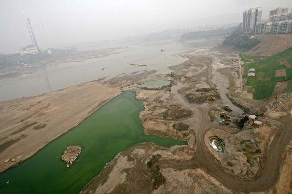 Dredgers excavate sand at river beach of Yangtze River in Chongqing Municipality, China, on Feb. 3, 2007. (Getty Images)