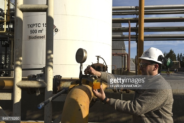 An engineer takes a sample of biodiesel from a storage tank at the industrial complex of the Louis Dreyfus Company in General Lagos, Santa Fe province, Argentina on Sep. 13, 2017.  (Photo credit should read EITAN ABRAMOVICH/AFP/Getty Images)