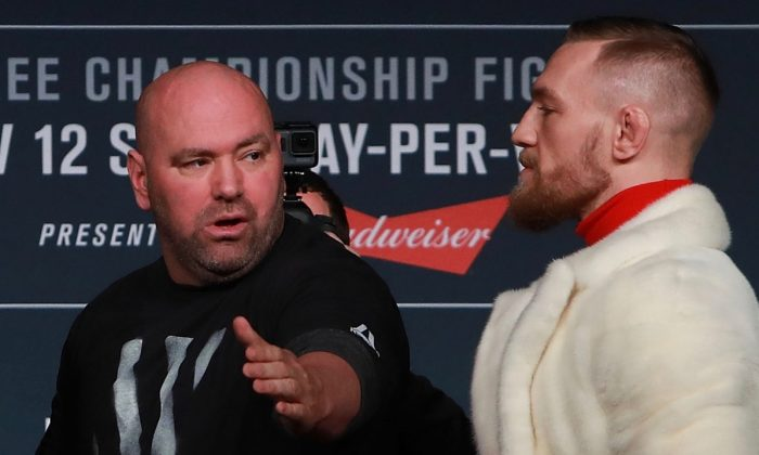 UFC President Dana White separates Conor McGregor from his opponent during the UFC 205 press conference at The Theater at Madison Square Garden on Nov. 10, 2016, in New York City.  (Michael Reaves/Getty Images)
