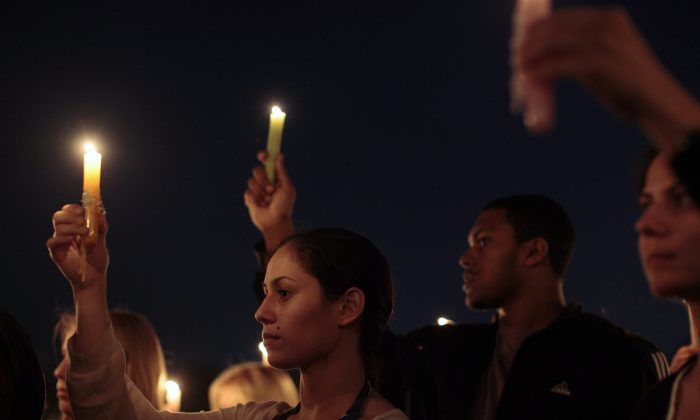 Students and visitors attend a candlelight vigil on campus at Virginia Tech April 16, 2012 in Blacksburg, Virginia. (Jared Soares/Getty Images)