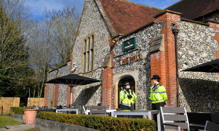 Police officers stand outside a pub near to where former Russian inteligence officer Sergei Skripal, and his daughter Yulia were found unconscious after they had been exposed to an unknown substance, in Salisbury on March 7, 2018. (Reuters/Toby Melville)