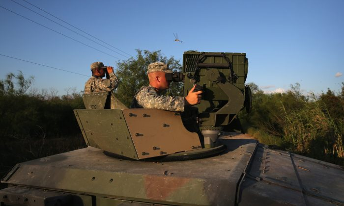 Texas National Guard soldiers operate a LRAS3 surveillance system while monitoring the U.S.-Mexico border on Sept. 11, 2014, in Havana, Texas. (John Moore/Getty Images)