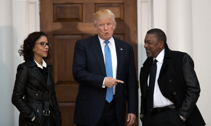 President-elect Donald Trump (C) greets Robert Johnson (R), the founder of Black Entertainment Television, and his wife Lauren Wooden (L) as they arrive for a meeting with president-elect Donald Trump at Trump International Golf Club, November 20, 2016 in Bedminster Township, New Jersey. (Drew Angerer/Getty Images)