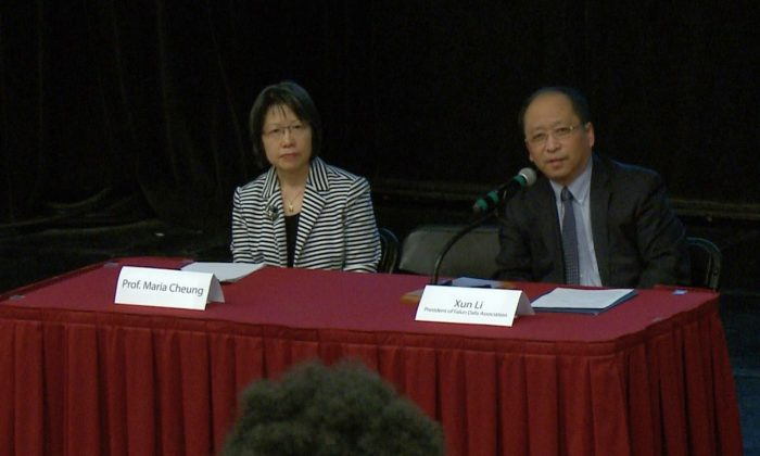 """Panellists Maria Cheung, an assistant professor and a research affiliate with the Centre for Human Rights Research at the University of Manitoba, and Xun Li, president of the Falun Dafa Association of Canada, at a panel discussion following a screening of the documentary """"Hard to Believe"""" at the University of Ottawa on April 5, 2018. (Jian Ren/The Epoch Times)"""