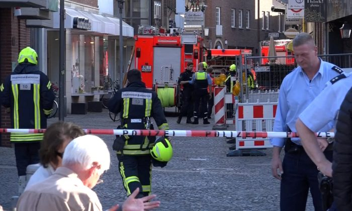 Police block a street near a place where a vehicle drove into a group of people killing several and injured many in Muenster Germany, April 7 2018. (Reuters/NonstopNews)