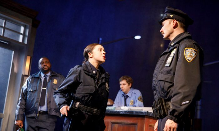 """(L–R) Brian Tyree Henry, Bel Powley, Michael Cera, and Chris Evans as they appear in Kenneth Lonergan's """"Lobby Hero"""" at Broadway's Helen Hayes Theater. (Joan Marcus)"""