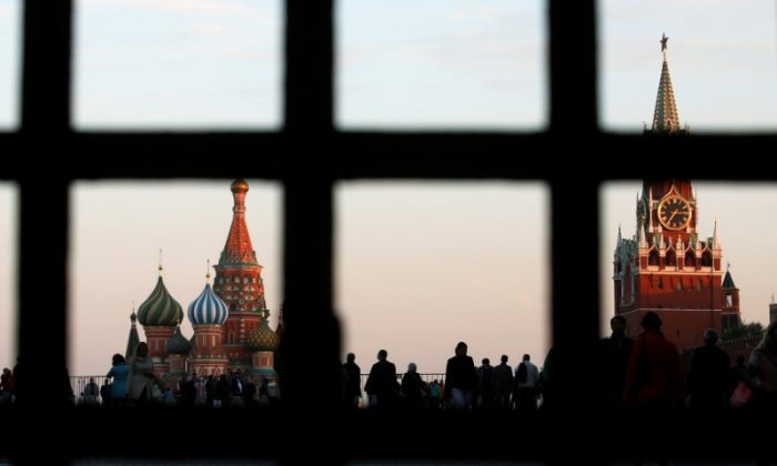Red Square, St. Basil's Cathedral (L), and the Spasskaya Tower of the Kremlin are seen through a gate in central Moscow on Sept. 18, 2014. (Reuters/Maxim Zmeyev/File Photo)