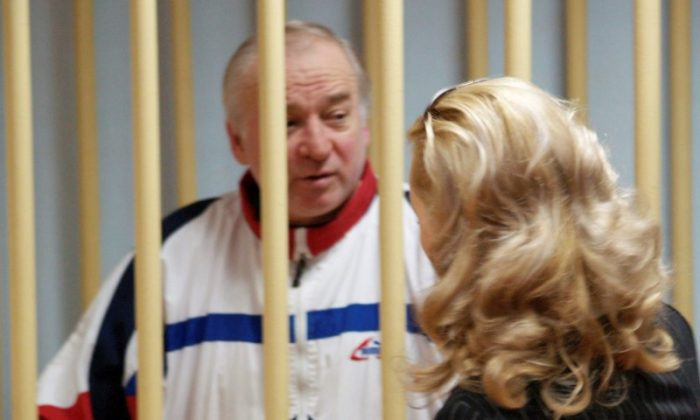 Sergei Skripal, a former colonel of Russia's GRU military intelligence service, looks on inside the defendants' cage as he attends a hearing at the Moscow military district court, Russia August 9, 2006. (Kommersant/Yuri Senatorov via Reuters)