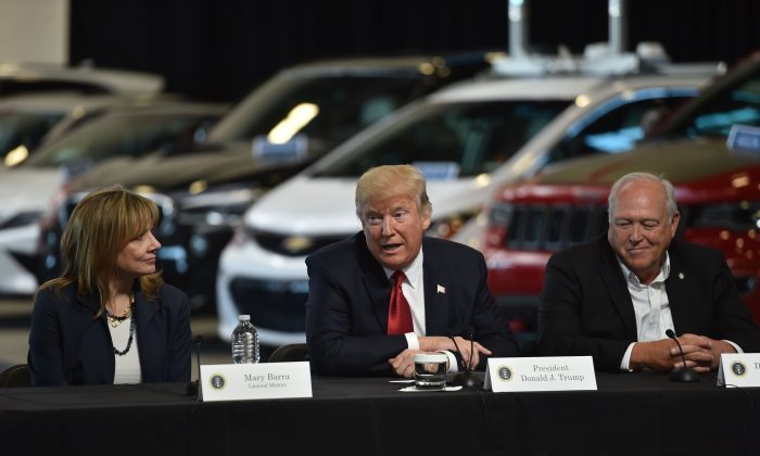 President Donald Trump delivers remarks at American Center for Mobility in Ypsilanti, Michigan with General Motors CEO Mary Barra, and United Auto Workers President Dennis Williams, on March 15, 2017. (Nicholas Kamm/AFP/Getty Images)