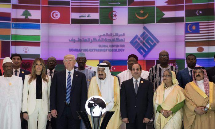U.S. President Donald Trump (3L), U.S. First lady Melania Trump (2L), Saudi Arabia's King Salman bin Abdulaziz al-Saud (C), and Egypt's President Abdel Fattah el-Sisi (3R) pose during the inauguration of the Global Center for Combating Extremist Ideology in Riyadh on May 21, 2017. (MANDEL NGAN/AFP/Getty Images)