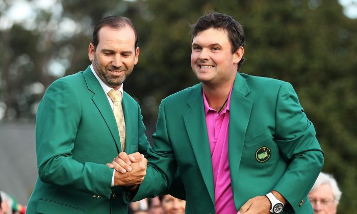 Patrick Reed (R) is congratulated by Sergio Garcia after being presented the green jacket for winning the 2018 Masters Tournament at Augusta National Golf Club on April 8, 2018 in Augusta, Georgia. (Patrick Smith/Getty Images)