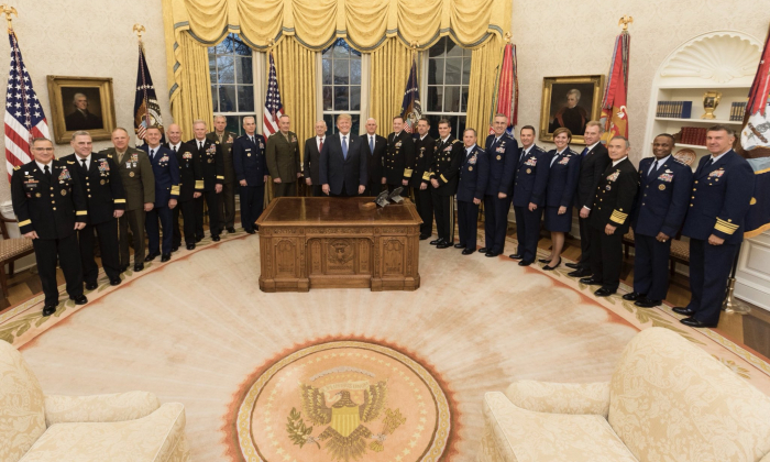 President Donald Trump stands for a photo with U.S. military commanders at the White House on April 9, 2018. (Public Domain)