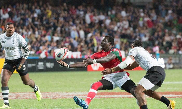 Kenya (red shirts) and Fiji in the final of the Hong Kong Rugby Sevens 2018, at Hong Kong Stadium on Sunday April 8. Fiji won a tightly contested match24-17 to take their fourth consecutive Hong Kong Sevens title. (Dan Marchant)