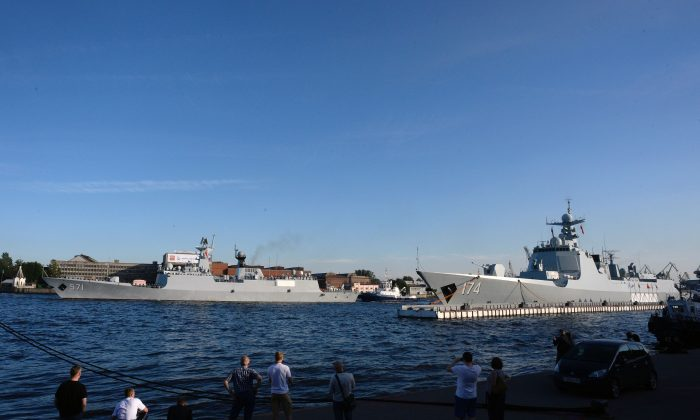 Chinese Type 052D missile destroyer Hefei (R) and Chinese Type 054A frigate Yuncheng docked in Saint Petersburg, Russia, on July 27, 2017. (Olga Maltseva/AFP/Getty Images)