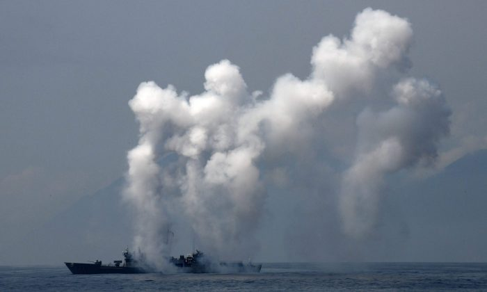 A frigate launches chaff and flare during a drill at the sea near the Suao navy harbor in Yilan, eastern Taiwan, on April 13, 2018.