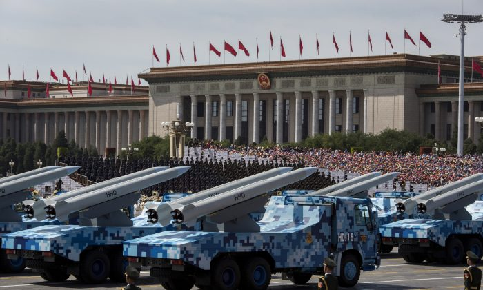 Chinese missiles are seen on trucks as they drive next to Tiananmen Square and the Great Hall of the People during a military parade on September 3, 2015 in Beijing, China. (Kevin Frayer/Getty Images)