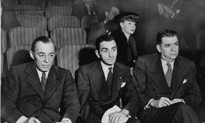 Richard Rodgers (L) and Oscar Hammerstein II (R), with composer Irving Berlin (middle) and choreographer Helen Tamiris, watch auditions at the St. James Theatre in 1948. (Public Domain)