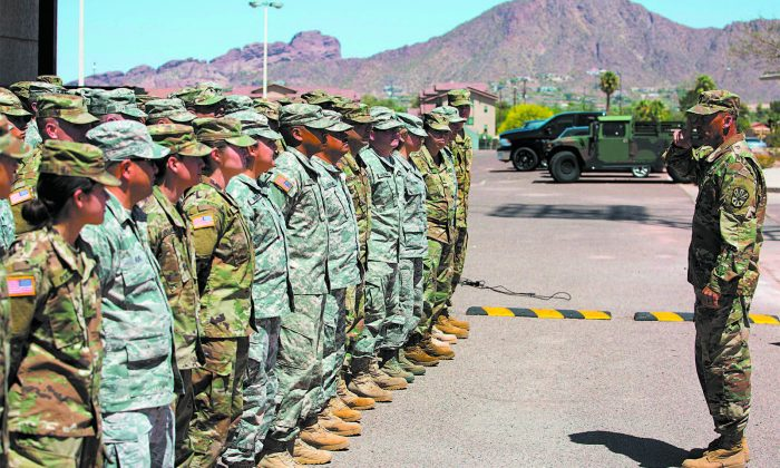 Members of the Arizona National Guard at the Papago Park Military Reservation in Phoenix on April 9. Arizona deployed its first 348 National Guard members to the Mexican border by April 10, after President Donald Trump ordered troops to boost border security. (CAITLIN O'HARA/AFP/GETTY IMAGES)