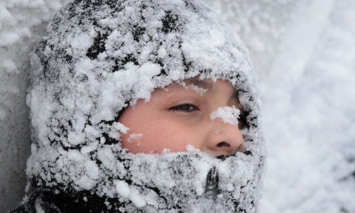 A file photograph shows a child in the snow in Chicago, Illinois Feb. 9 2018. (Scott Olson/Getty Images)