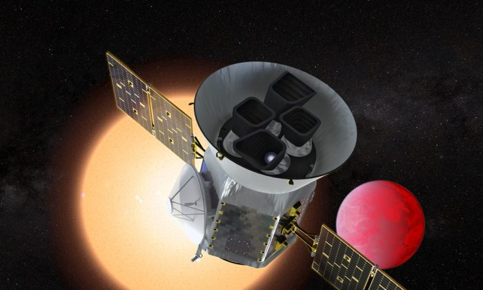Artist concept of TESS in front of a lava planet orbiting its host star.(NASA's Goddard Space Flight Center)