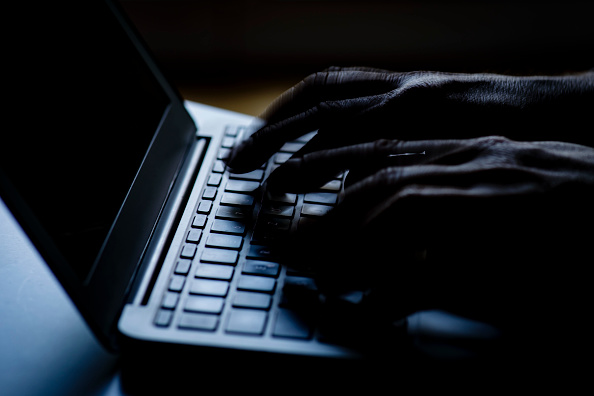 Hands type on a computer keyboard in this file image on Feb. 6, 2018. (Thomas Trutschel/Photothek via Getty Images)