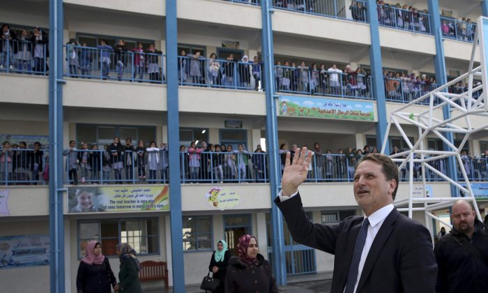 UNRWA's commissioner-general Pierre Krahenbuhl waves to refugee students at the UNRWA Rimal Girls Preparatory School in Gaza City Jan. 22, 2018, during the launch of a global fundraising campaign seeking hundreds of millions of dollars in response to funding cuts by the Trump administration. (AP Photo/Adel Hana)