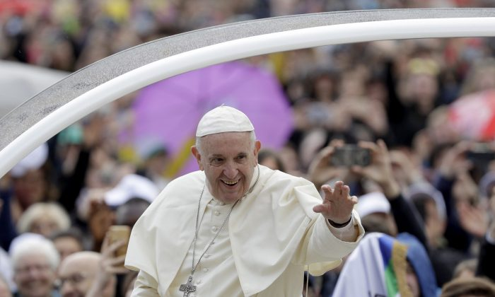 Pope Francis arrives for his weekly general audience in St. Peter's Basilica at the Vatican on April 18, 2018. (AP Photo/Gregorio Borgia)